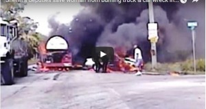 sheriff deputies save woman from burning car